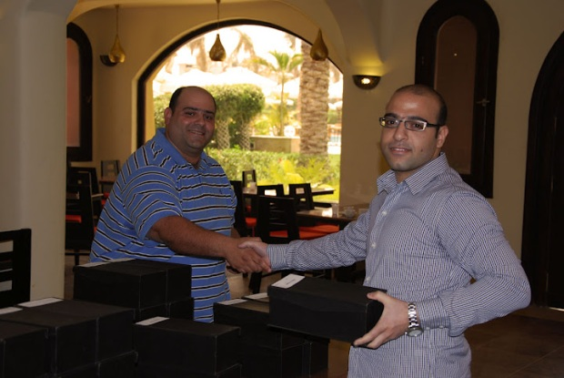 Hany Foud - IT Department receiving his award from Raphael Emil