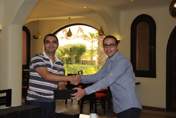 Mohamed Omar - Software Development Department receives his award from Mohamed Salah