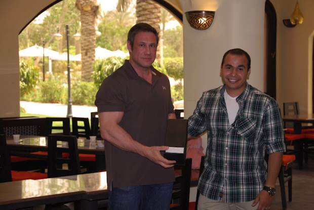 Wael - Sales Department receives his award from Lars Mourey